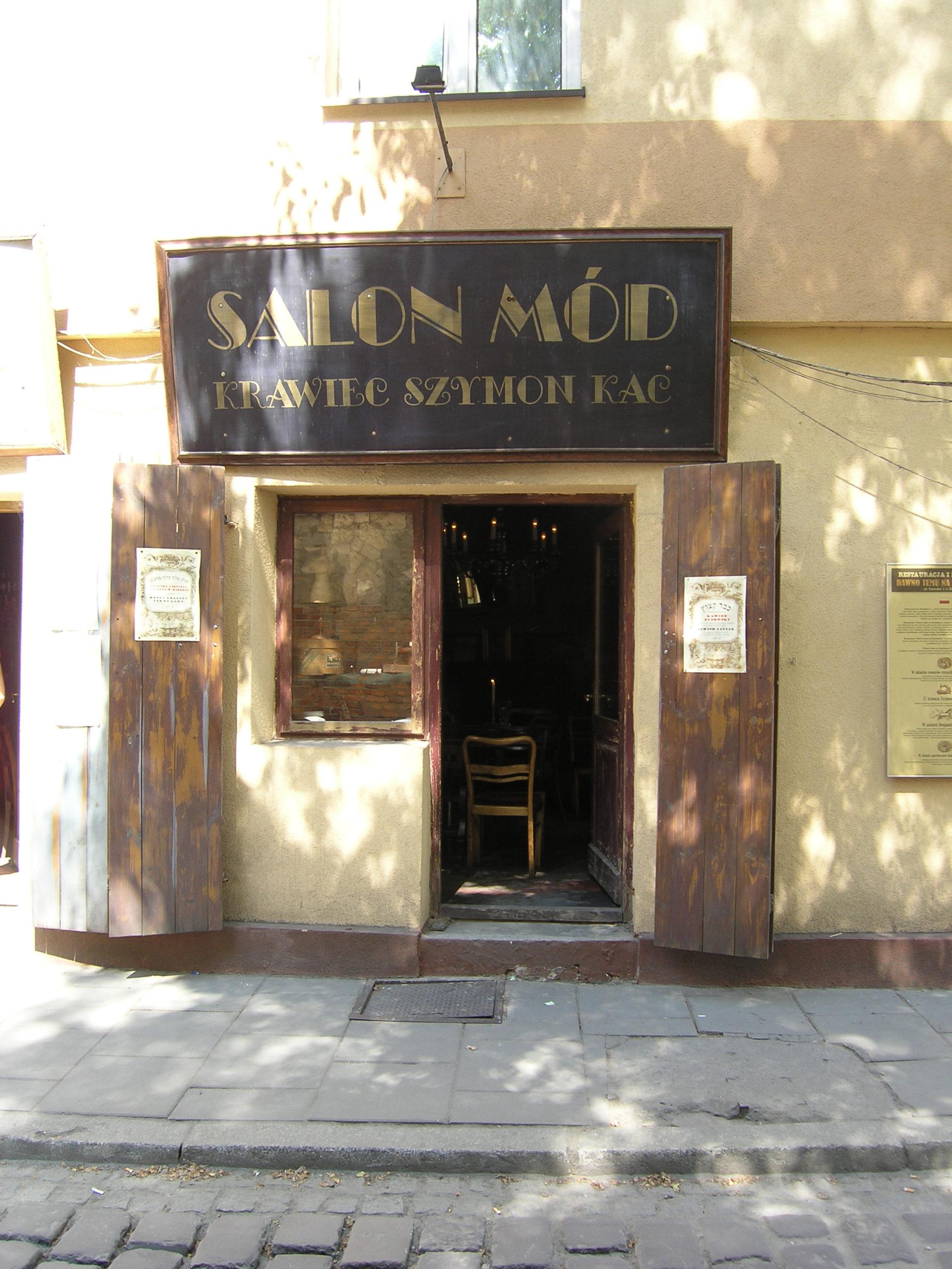 Kraków salon mód stary szyld